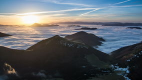 Colorful sunrise morning above mist clouds flows in mountain valley time lapse stock video