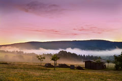 Colorful sunrise in mountains Stock Image