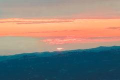 A Colorful sunrise and mountains. The Colorful sunrise and mountains Royalty Free Stock Photos