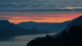 Colorful Sunrise with Moving Clouds along Beautiful Columbia River Gorge in Oregon Timelapse 1080p stock video footage