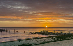 Colorful sunrise at old village of fishermen, Baltic Sea Stock Photos