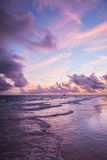 Colorful sunrise over Atlantic Ocean coast. Bavaro beach, Hispaniola Island. Dominican Republic, vertical photo Royalty Free Stock Photography