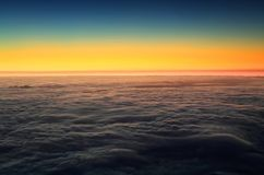Colorful sunrise over the Atlantic Ocean seen from Pico Volcano. Clouds formation at sunrise over the Atlantic Ocean, seen from Pico volcano 2351m, Pico Island Royalty Free Stock Images