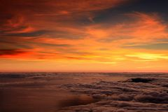 Colorful sunrise over the Atlantic Ocean seen from Pico Volcano. Clouds formation at sunrise over the Atlantic Ocean, seen from Pico volcano 2351m, Pico Island Royalty Free Stock Photography