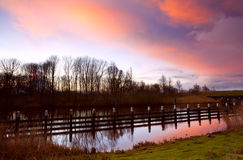 Colorful sunrise over canal Stock Photo