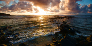 Colorful Sunrise over the Hawaii. Tropical island of Kauai with waves and ocean surf Stock Images