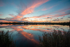 Colorful sunrise over the lake Stock Image