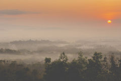 Colorful sunrise over Merapi volcano and Borobudur temple in mis Stock Photography