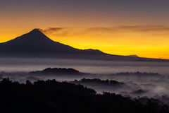 Colorful sunrise over Merapi volcano, Indoneisa Royalty Free Stock Photo