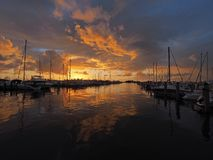 Sunrise over Dinner Key Marina in Coconut Grove, Miami, Florida. Colorful sunrise after a rainstorm over Dinner Key Marina in Coconut Grove, Miami, Florida royalty free stock photo