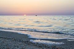 Colorful sunrise on the sea coast Stock Image
