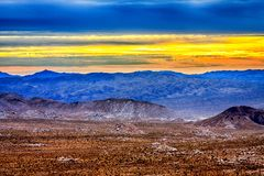 Amazing Yellow Sunrise Over the Desert. Colorful sunrise after a very stormy night in Joshua Tree National Park Stock Photo