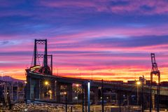 Colorful sunrise at the Vincent Thomas Bridge in San Pedro, California. Long exposure of colorful sunrise at the Vincent Thomas Bridge in San Pedro, California royalty free stock photos