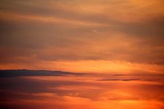 Colorful Sunset. Colorful Orange and Violet Sunset in Clouds Stock Photos