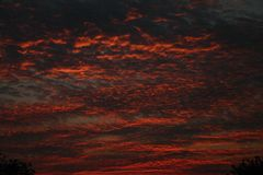 Colorful sunset. With interesting pattern to clouds Royalty Free Stock Image