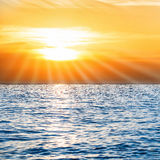 Colorful sunset above blue sea Stock Images