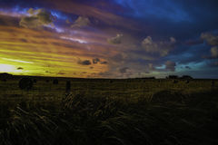 Colorful Sunset. Above farmland with hay bales Stock Photography