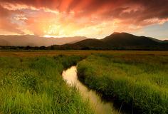 Colorful sunset above a stream in Heber Valley. Sunset stream in rural Utah, USA Stock Photos