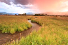Colorful sunset above a stream in Heber Valley. Sunset stream in rural Utah, USA Royalty Free Stock Images