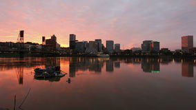 Colorful Sunset along Willamette River with Cityscape and Hawthorne Bridge in Portland Oregon Time Lapse 1080p Stock Photo
