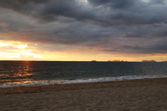 The colorful sunset on a beach on a cloudy weather. Royalty Free Stock Photo
