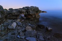Enjoying the colorful sunset on a beach with rocks on the Adriatic Sea coast Istria Croatia royalty free stock images
