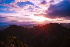 A colorful sunset with a beautiful view from the Tiger Cave Mountain over the mountains of Krabi, Thailand royalty free stock photos