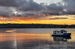 Colorful sunset with a boat  in Lake Taupo, New Zealand Stock Image