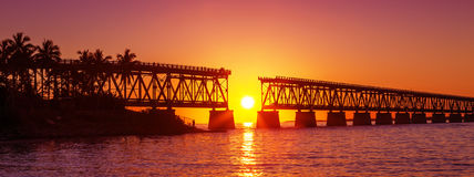 Colorful sunset at broken bridge. Colorful sunset or sunrise with broken bridge Royalty Free Stock Image