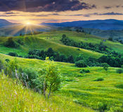 Colorful sunset in Carpathian mountains. Stock Photos