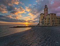 Colorful sunset and the Church of Santa Maria Assunta, Camogli, Liguria, Italy. Colorful sunset and the Church of Santa Maria Assunta lying on the sea and stock photo