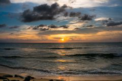 Cloudy colorful golden hour sunset at seashore stock photo