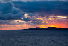 Colorful sunset among the dark clouds Royalty Free Stock Photography