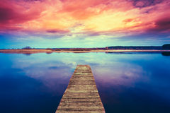 Colorful sunset dramatic sky over wooden boards Royalty Free Stock Photography