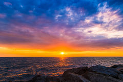 Colorful sunset in the evening over the ocean Royalty Free Stock Photos
