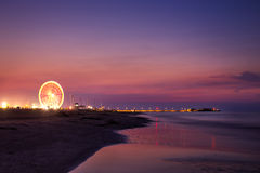 Colorful sunset with ferris wheel Stock Photography