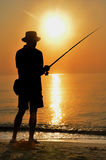Colorful sunset fisherman silhouette Stock Photos