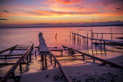 Colorful sunset and the fishing pier Royalty Free Stock Images