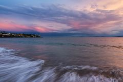 Colorful sunset at the fishing village near Ravda, Bulgaria. Sea sunset at Black Sea coast.  royalty free stock images