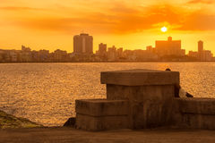 Colorful sunset in Havana with El Malecon seawall. On the foreground Royalty Free Stock Images