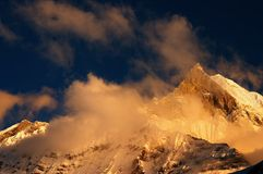 Colorful sunset in Himalaya. Machhapuchhre mountain (Fishtail), Nepal, Himalaya Stock Images