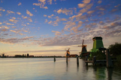 A colorful sunset in Holland with windmills Stock Photos
