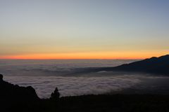 Colorful sunset at La Palma with a view over low-hanging clouds Stock Photo