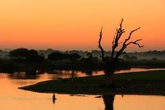 Colorful sunset at the lake, Amarapura, Myanmar Royalty Free Stock Images