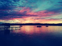 Colorful sunset at lake stock images