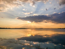 Colorful sunset and lake reflections on Morii Lake, Bucharest Royalty Free Stock Photography