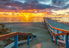 Colorful sunset at marine pier, Baltic Sea, Lithuania. Аamous marine pier in the Baltic resort city of Palanga, Lithuania, Europe Royalty Free Stock Photography