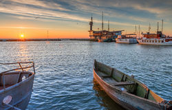 Colorful sunset at marine pier, Baltic Sea, Lithuania. Famous marine pier in the Baltic resort city of Nida, Lithuania, Europe Royalty Free Stock Photography
