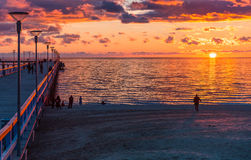 Colorful sunset at marine pier, Baltic Sea, Lithuania royalty free stock photography