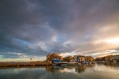 A colorful sunset on the Mediterranean Sea overlooking the cozy Port Saplaya area in Valencia. Spain royalty free stock photo
